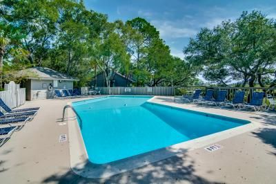Photo for Two story villa with views of Cap'n Sam's Creek and community pool access