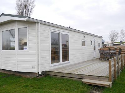 Photo for Attractive chalet situated in a holiday park with playground, right by the Wadden Sea