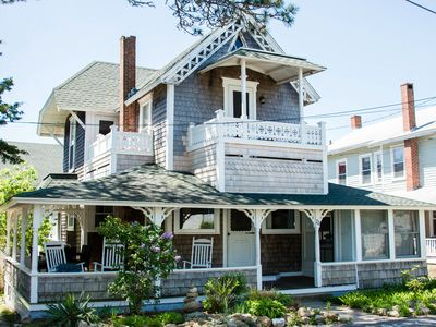 Photo for Updated & Elegant, in-town WATERVIEW Victorian. 1 block from beach.  BIG porch.