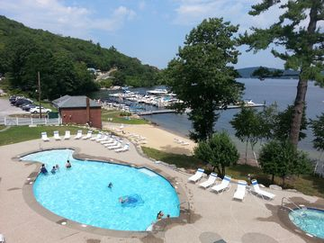 Lake & Mountain Views. Resort Pool, Beach, Hot Tub, Beach Bar, & Other Amenities