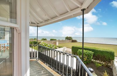 Photo for Panoramic sea views from our beautiful beach front house.