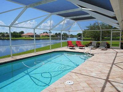 Photo for Blue Oasis - SW Cape Coral 3b/2ba Elect Heated Pool, Gulf Access Canal, HSW Internet, Boat Dock, 2 k