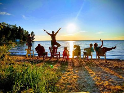 Photo for Sand beach! Wet Sauna! Crystal clear water! Sunsets! Rustic yet modern home!