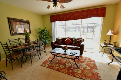 Family Room with sliding glass doors leading to Pool and Patio.