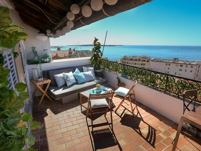 Photo for Top floor apartment with large terrace overlooking Cannes bay.