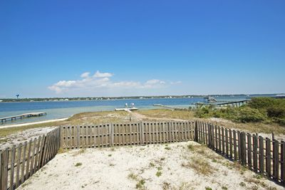 Private, fenced in backyard with a Bay view.