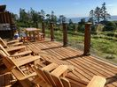 Ocean view deck with Adirondack chairs, BBQ and picnic table