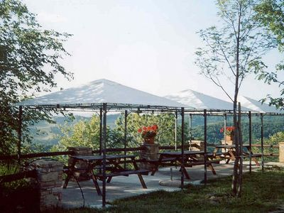 Photo for Villa Ciranda B: A welcoming apartment built on a hillside, surrounded by meadows and woods, with Free WI-FI.