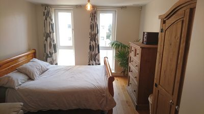 Photo for Modern apartment set in green riverside location close to town centre