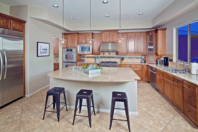 Upgraded kitchen with granite counters, solid cabinets, and brand appliances.