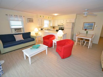 Photo for Spacious, stylishly-minimalist 3 bedroom condo with free WiFi and cute beach-themed trimmings located uptown on the ocean block just a mere stroll to the beach!
