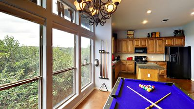 Pool Table - A pool table between the kitchen and living area offers hours of entertainment