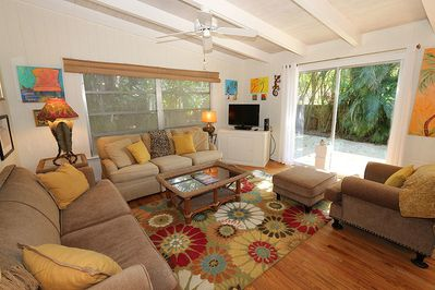 Cozy living area with sliding glass door that gives the space tons of natural life.