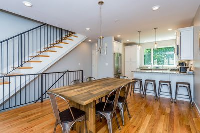 Dining Area - Dining for 6 and gorgeous hardwoods in this brand-new Asheville townhome, professionally managed and maintained by TurnKey Vacation Rentals.