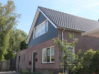 Photo for Modern spacious holiday home with lovely backyard and veranda in Limmen