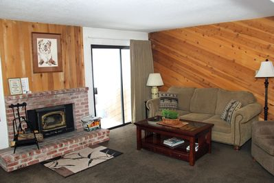 Mammoth Condo Rental Wildflower 59 - LR with Woodstove and Outside Deck Access