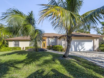 Photo for Tropical bungalow with screened porch, grill, and more - great location!