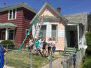 Church youth helped Ona paint her house in the summer of 2015.