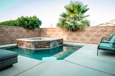 Pool/spa patio area with privacy from a high brick fence