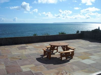 Photo for CHALET BUNGALOW WITH LARGE PATIO OVERLOOKING THE SANDY BEACH-HB2656