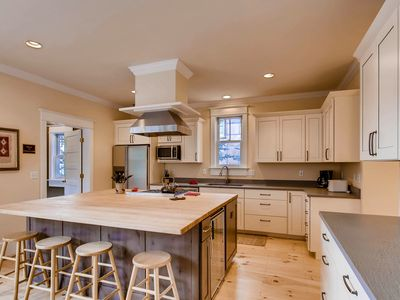Photo for Walk to everything from this newly remodeled in-town retreat; hot tub & views