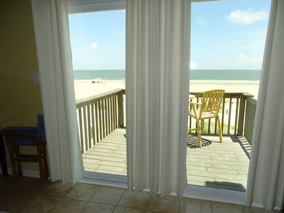 Enjoy a beautiful sunrise with your morning coffee on this condo's balcony!