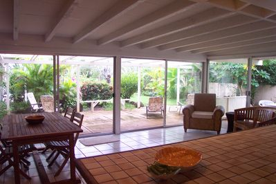 Dining area looking out on main lanai and tropical garden