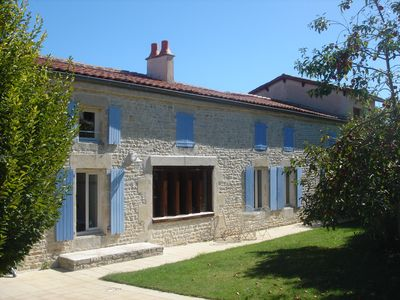 Photo for Beautiful renovated farmhouse with private heated pool.