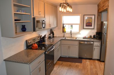 Fully stocked kitchen with all dishes, cookware and appliances for convenience