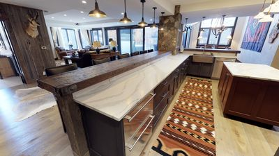 kitchen, family, dining to siding doors and outdoor patio and hot tub