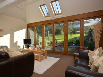Lounge area with large doors to enjoy the garden in any weather