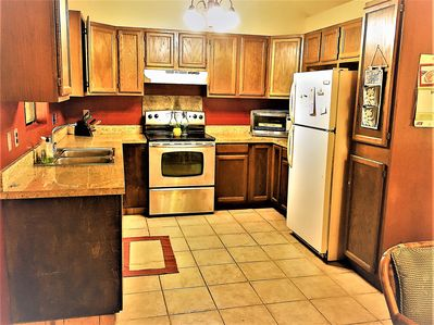 Beautiful Kitchen features granite counter tops and lots of space to work in.