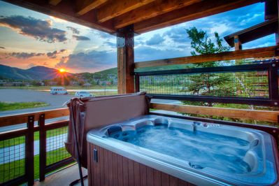 Relax on the deck in your own private hot tub