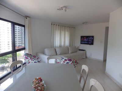 Photo for BEAUTIFUL APARTMENT ON THE BEACH OF ASTURIAS GUARUJA
