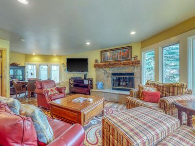 Photo for Marvelous riverfront home with private hot tub & easy ski access!