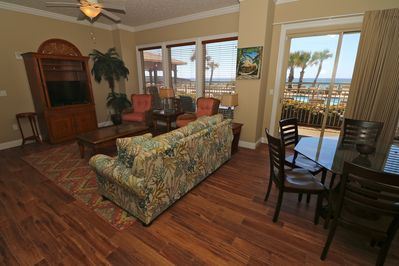 Living room with view of the ocean.  Has a pull out couch and large flat screen tv.