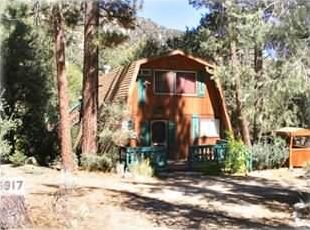 Cabin exterior view--quiet and private with large trees~~