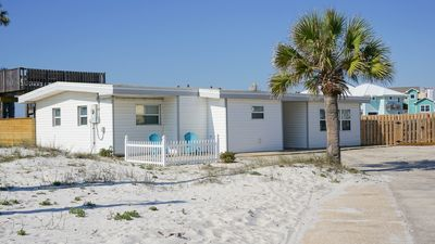 Photo for Cozy old Florida style Beach Cottage with roof top deck with amazing views!