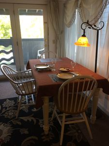 The dining table seats up to four.