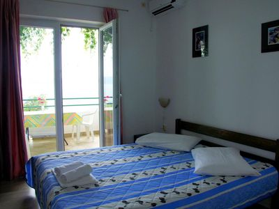 Photo for Two bedroom apartment with balcony and sea view Živogošće - Porat, Makarska (A-16289-d)