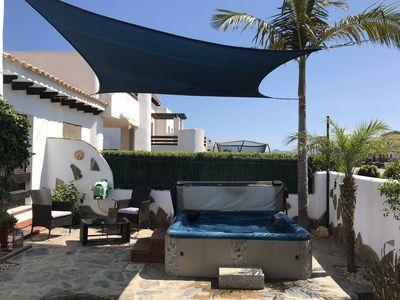 Photo for Lovely 2 Bed Villa with Air Con, FREE WIFI & Large Hot-Tub in Private Garden