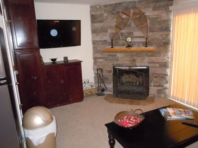 Living area - wood fireplace, walk-out patio, 42' TV, queen sofa sleeper