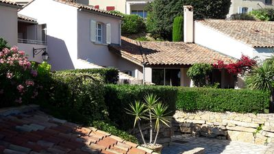 Photo for Provencal house in a guarded village, golf course, swimming pool, tennis, sea view.