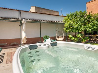 Photo for Cosy Holiday Home with Wi-Fi, Air Conditioning, Garden, Terrace & Jacuzzi