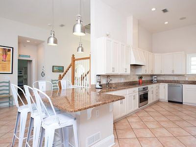 Kitchen - Cathedral ceilings and tile floors line the main space.