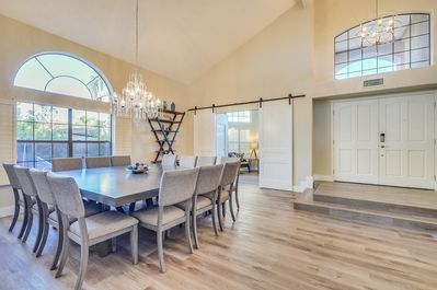 Spacious Entryway with Vaulted Ceilings, New Flooring and Contemporary Furniture