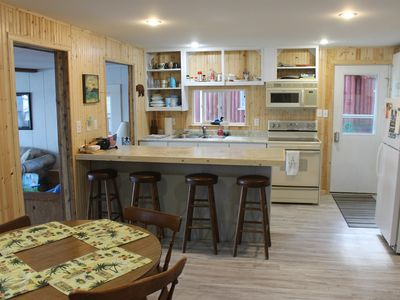 Photo for Sleeps Up To 12 People!  Directly On The Pristine Sandy Bottom All Sports Lake!