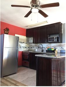 Photo for Cozy  apartment with beach 7 mins drive away. JEEP RENTAL , A.C , CABLE,WIFI,