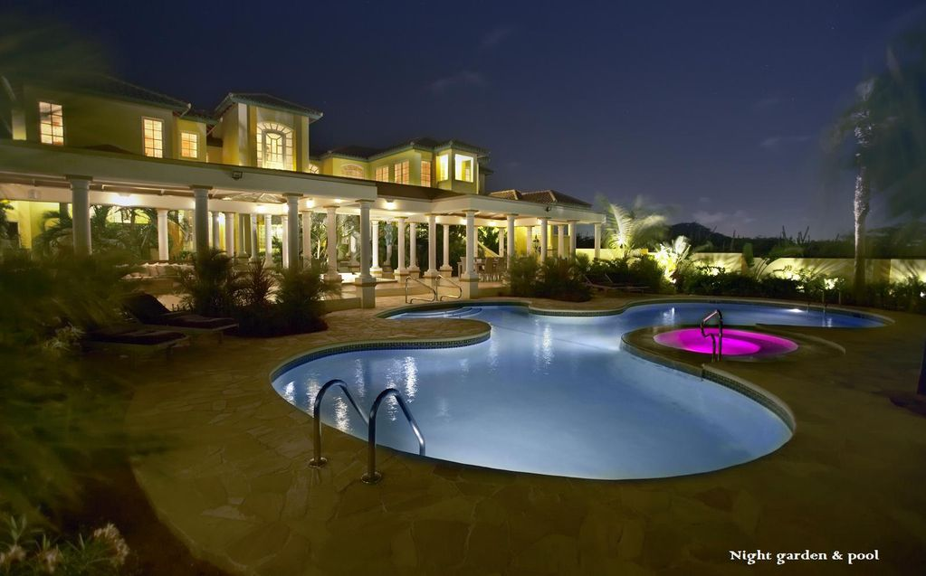 Mansion with pool at night  luxury mansion style villa with tropical... - HomeAway Noord