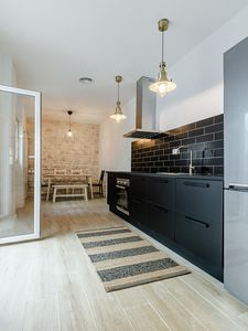 Photo for Beautiful Loft House w / Patio 10 mins to Center